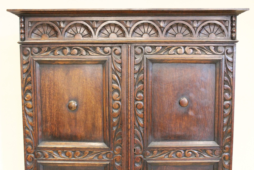 A 17th century style oak cabinet on stand, circa 1930, the lunette carved frieze above twin panelled - Image 3 of 3