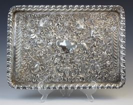 A late Victorian silver tray by William Comyns, London 1898, of rectangular form with gadroon