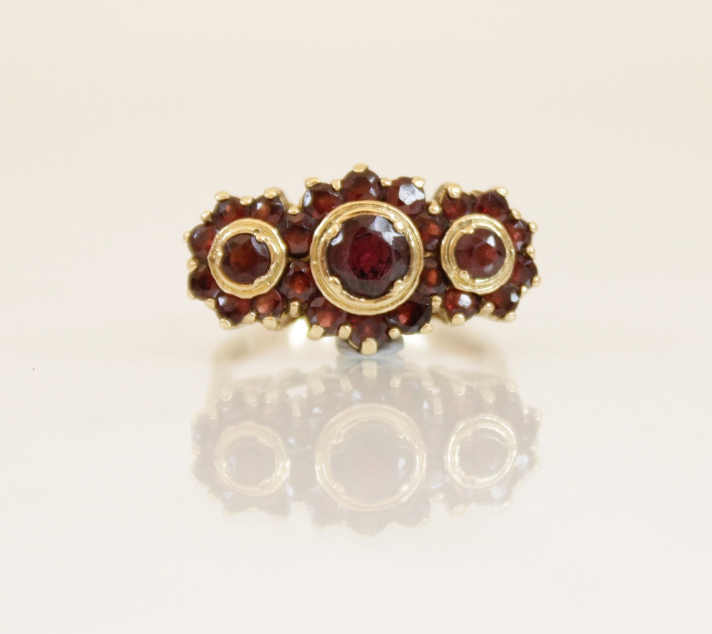 A 9ct gold garnet cluster ring, comprising three principle round mixed cut garnets (measuring - Image 3 of 4