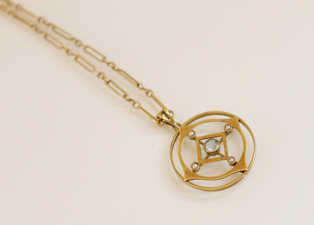 An Edwardian 15ct gold aquamarine and pearl set pendant, comprising a round mixed cut aquamarine
