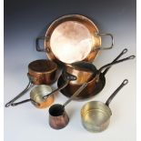 A selection of 19th century and later copper pans comprising; a graduated set of five saucepans, a