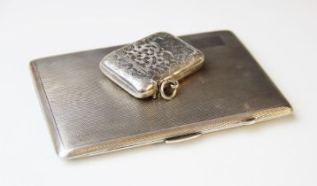 A George V silver cigarette case by E.J. Houlston, Birmingham 1919, of rectangular form with