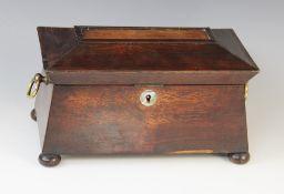 A William IV walnut tea caddy, early 19th century, of sarcophagus form on bun feet with drop ring
