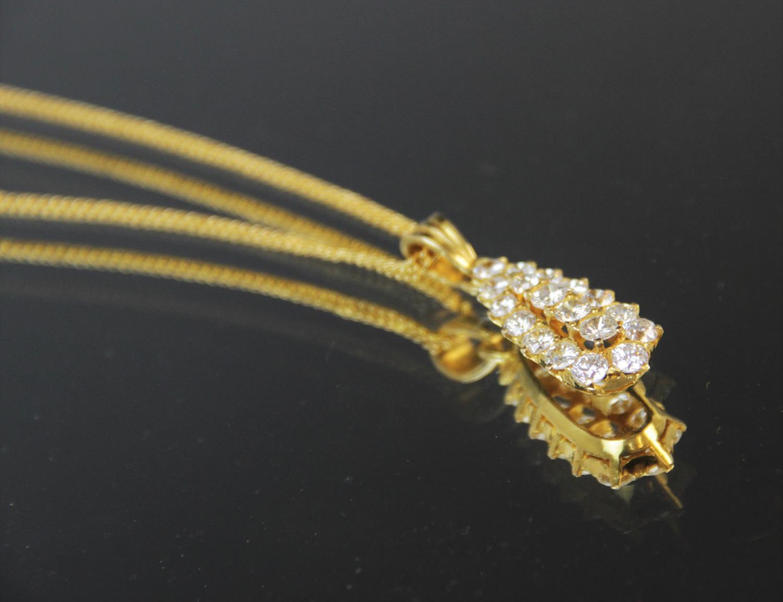 A diamond teardrop pendant, comprising eighteen round brilliant cut diamonds, (estimated diamond - Image 5 of 6
