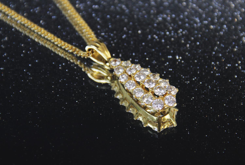 A diamond teardrop pendant, comprising eighteen round brilliant cut diamonds, (estimated diamond - Image 6 of 6