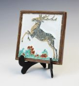 A Porceleyne Fles Royal Delft cloisonné tile depicting a leaping stag, early 20th century, impressed