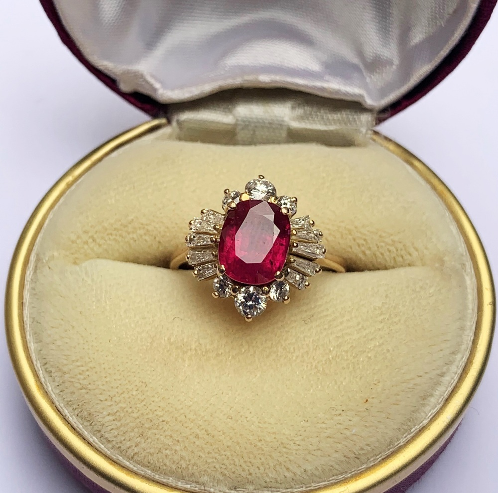 A ruby and diamond cluster ring, the central rectangular cushion cut ruby (measuring 8.2 x 6.6 x 4. - Image 6 of 10