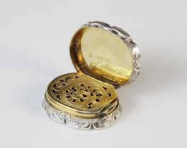 A Victorian silver vinaigrette by Edward Smith, London 1856, of oval form with scalloped borders,