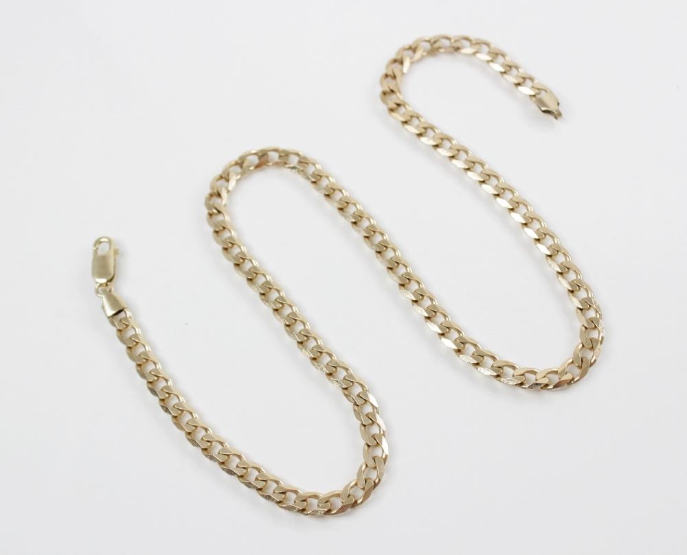 A 9ct gold curb-link chain, with lobster claw and loop fastener, 36cm long, weight 23.2gms