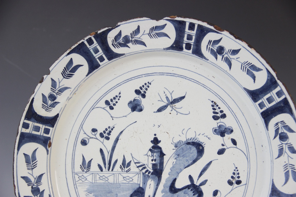 A Delft ware charger, 18th century, the tin glazed earthenware charger of circular form, the central - Image 2 of 6
