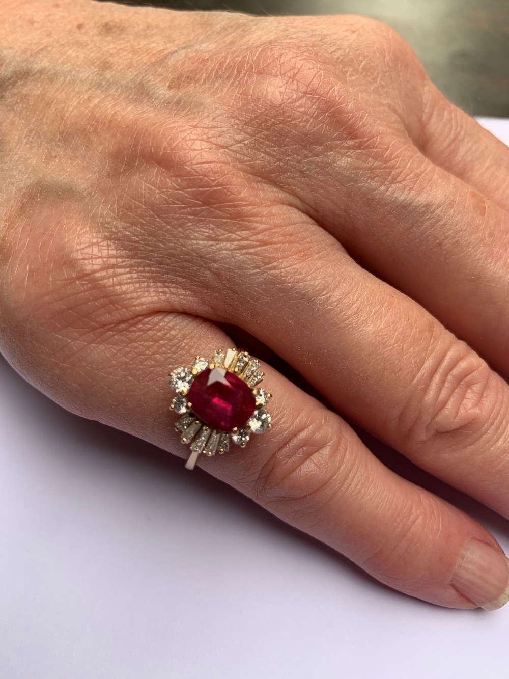 A ruby and diamond cluster ring, the central rectangular cushion cut ruby (measuring 8.2 x 6.6 x 4. - Image 7 of 10