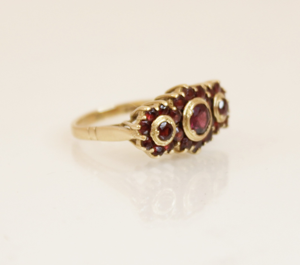 A 9ct gold garnet cluster ring, comprising three principle round mixed cut garnets (measuring - Image 4 of 4