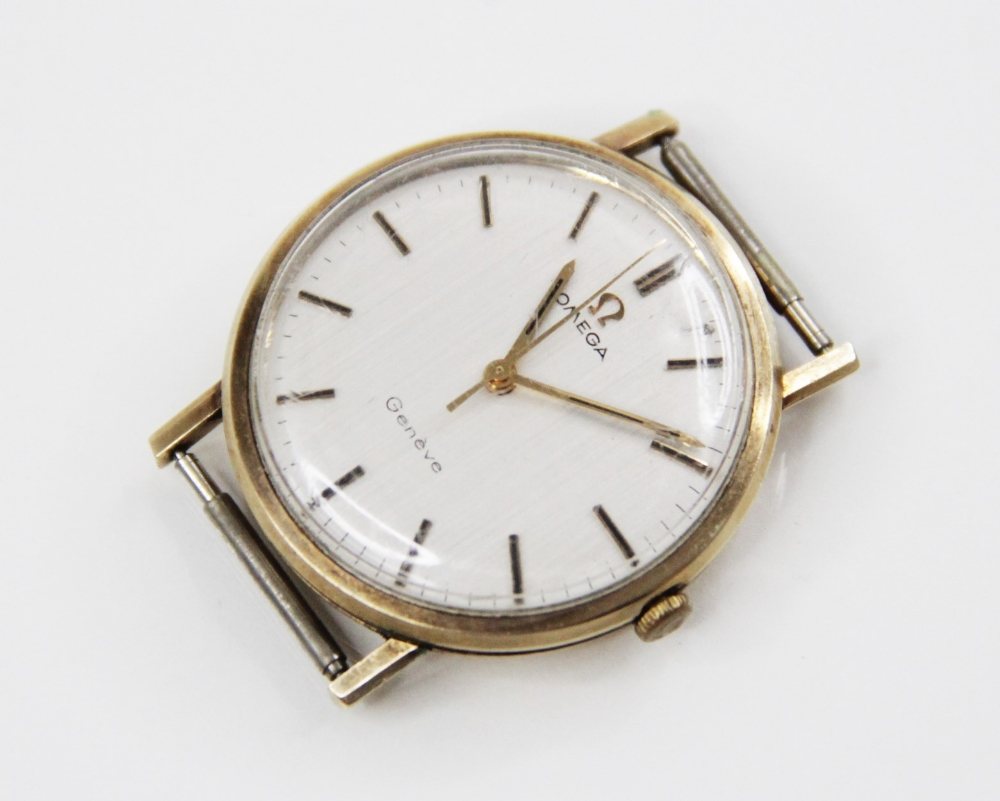 A gentleman's vintage Omega Geneve 9ct gold wristwatch, the round cream dial with baton markers, set