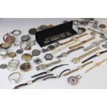 A collection of assorted watch parts, to include mechanical and battery powered movements, straps