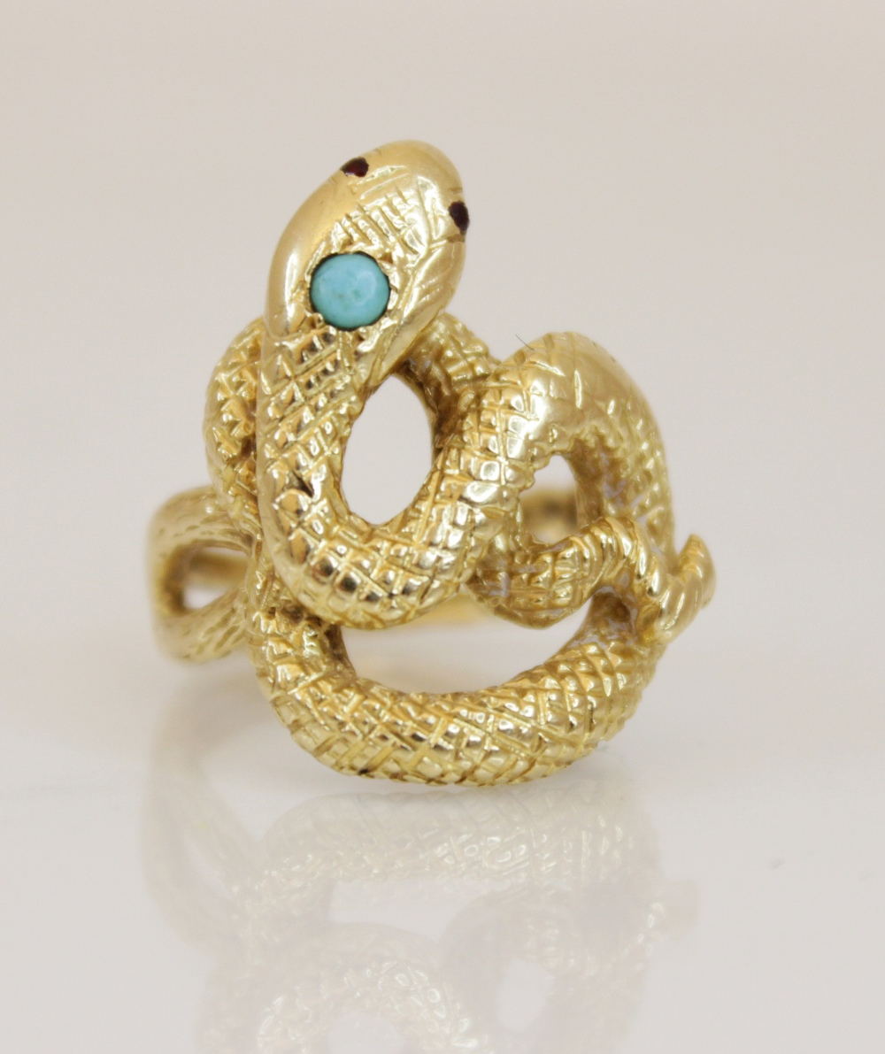 A continental 18ct gold turquoise and ruby set snake ring, the coiled body with engraved decoration, - Image 4 of 4