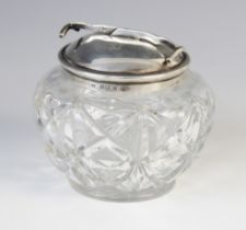 A George V cut glass sugar bowl and silver cover, marks for W. Coulthard Ltd, Birmingham 1931, the