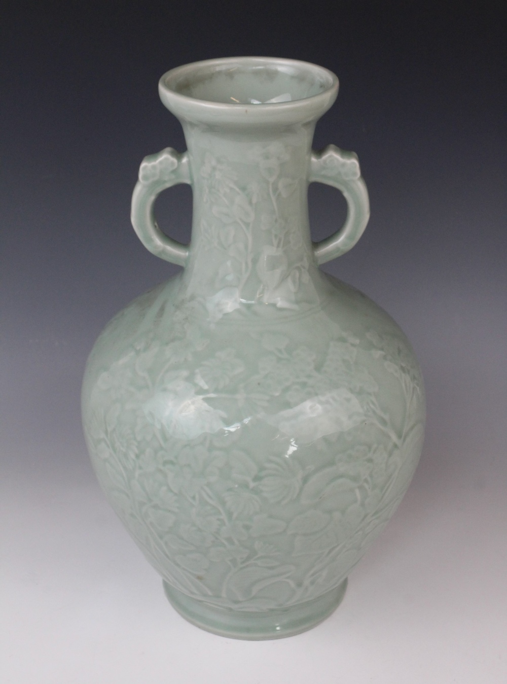 A Chinese Longquan celadon glazed vase, 20th century, the arrow-head type shaped twin handled vase - Image 2 of 3