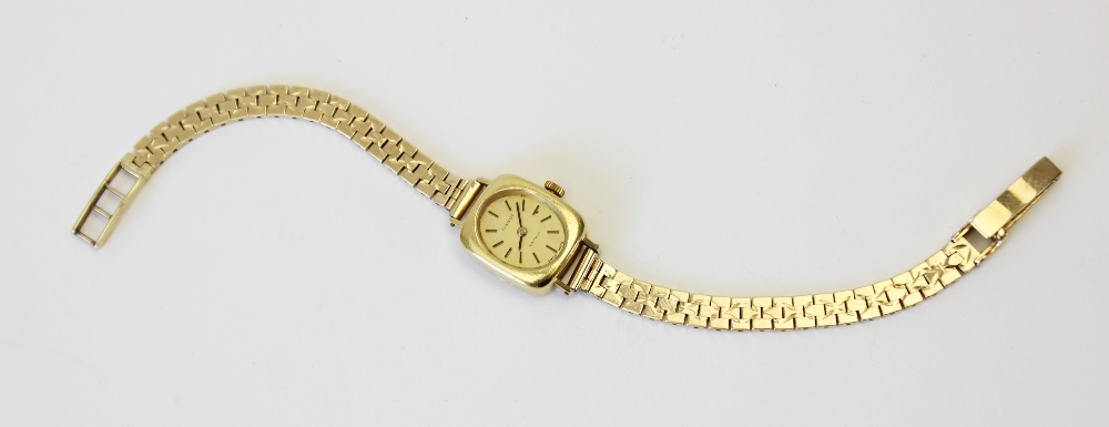 A lady's vintage 18ct gold Tissot Saphir wristwatch, gold toned oval dial with baton markers, set to