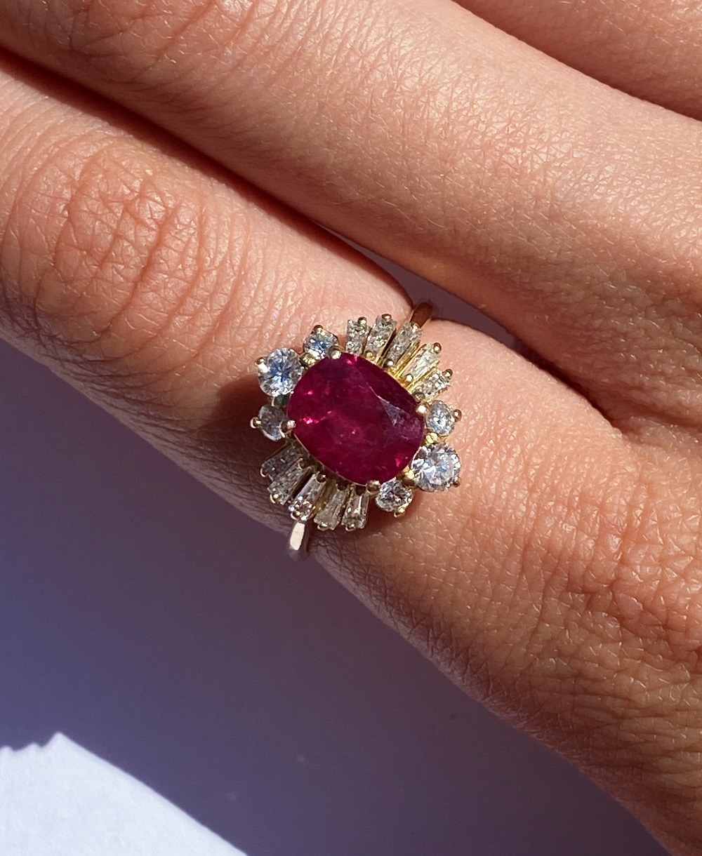 A ruby and diamond cluster ring, the central rectangular cushion cut ruby (measuring 8.2 x 6.6 x 4. - Image 3 of 10