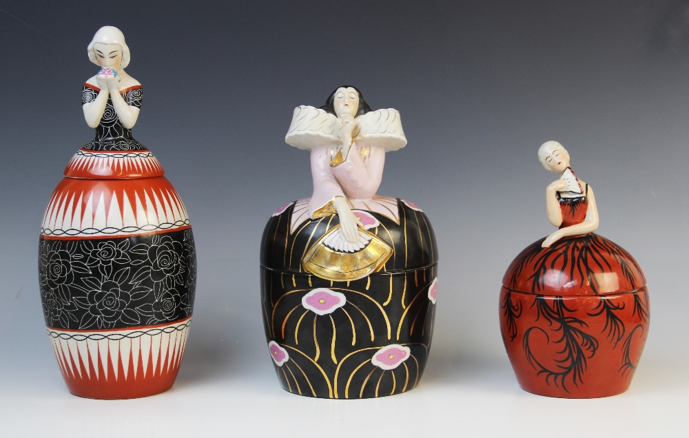Three French Art Deco bonbonnieres or jars and covers by Robj, early 20th century, each modelled