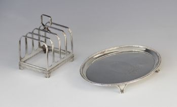 A George III silver teapot stand by Elizabeth Jones, London 1785, of oval form with beaded border on
