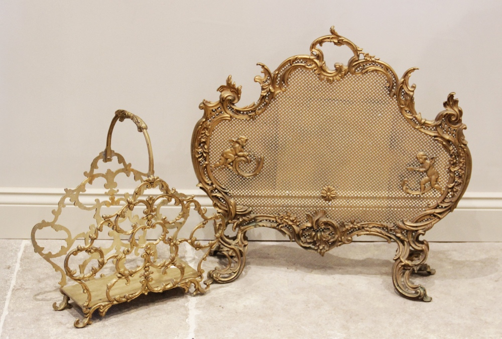 A Louis XVI gilt metal rococo style fire screen, mid 20th century, the 'C' scroll cast frame