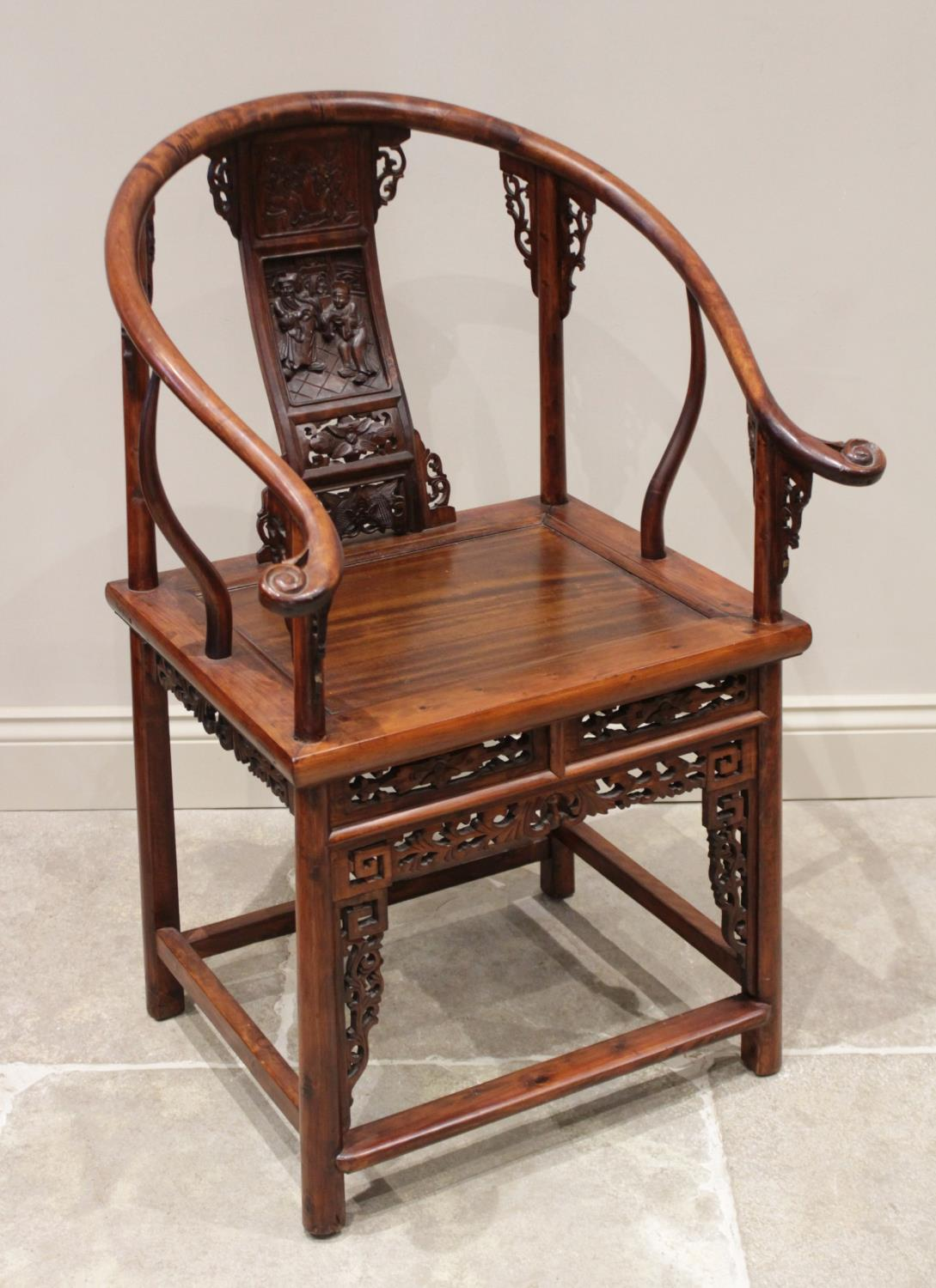 A Chinese stained wood altar chair, 20th century, the horse shoe shaped top rail with scrolled