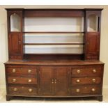 A George III oak and mahogany cross banded dresser, the inverted breakfront rack with three open