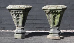 A pair of Gothic sandstone planters, possibly converted from roof finials, each of hexagonal