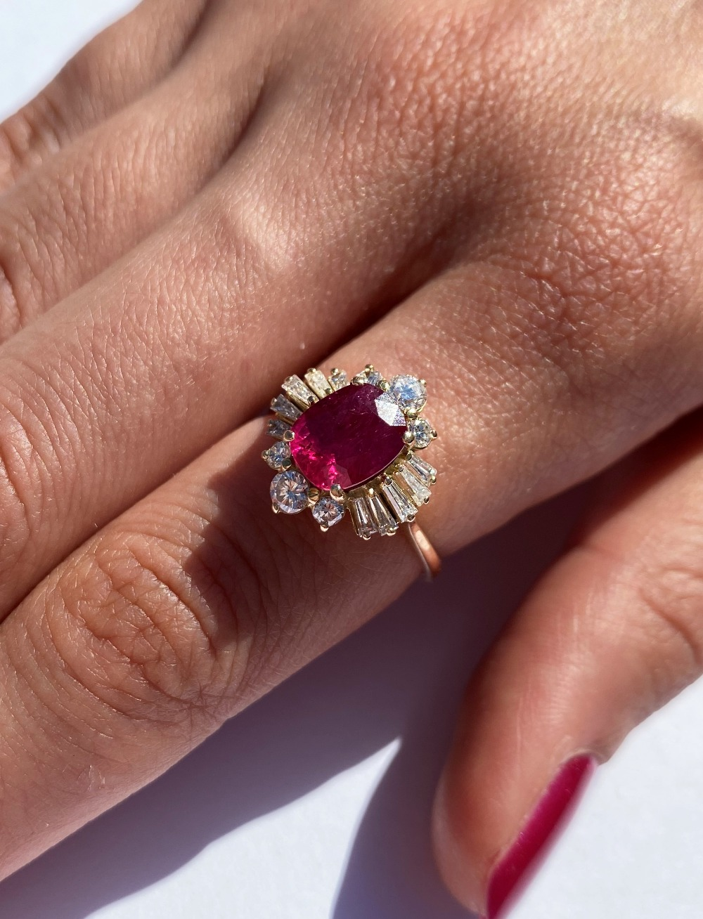 A ruby and diamond cluster ring, the central rectangular cushion cut ruby (measuring 8.2 x 6.6 x 4. - Image 5 of 10