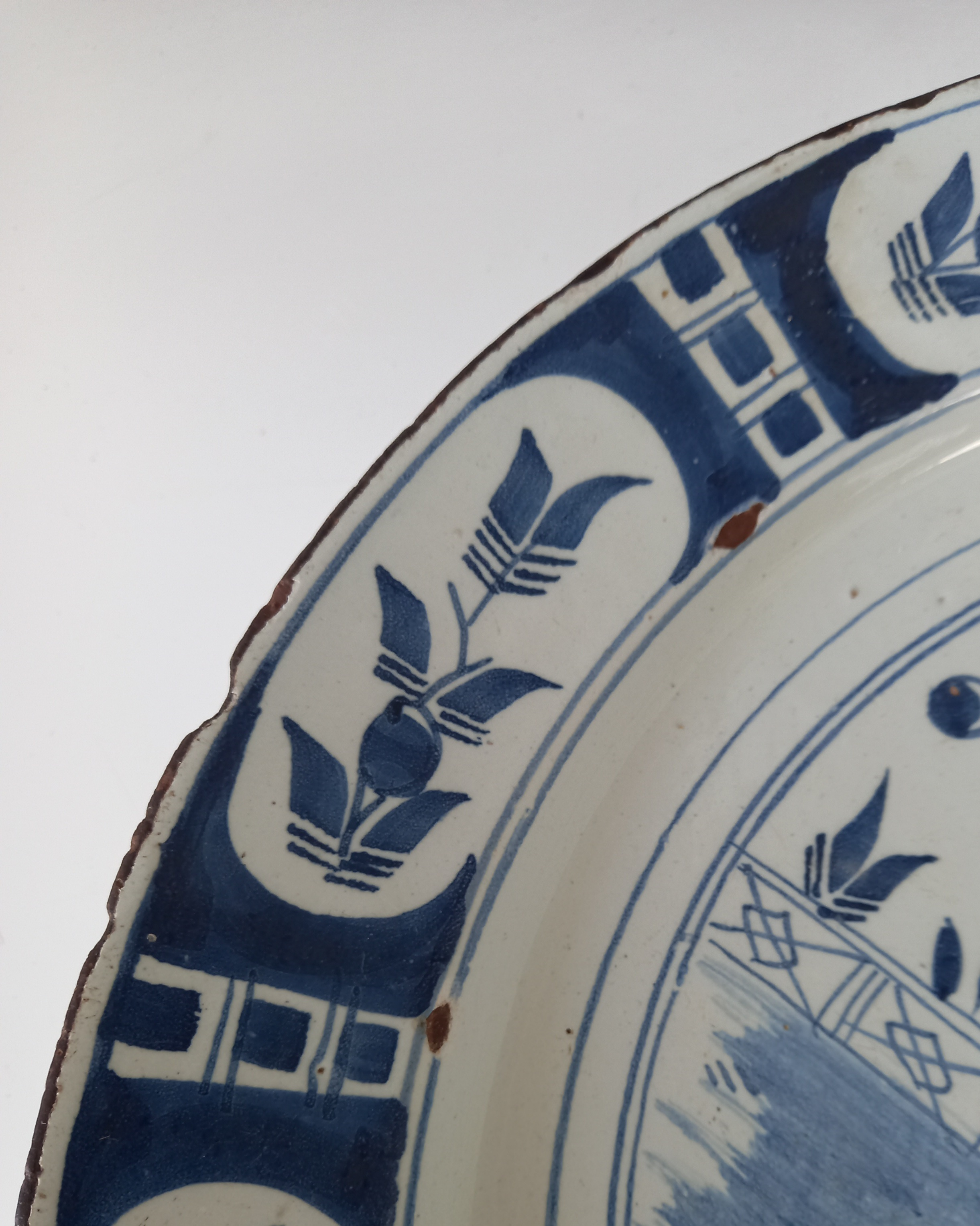 A Delft ware charger, 18th century, the tin glazed earthenware charger of circular form, the central - Image 4 of 6