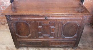 An 18th century oak coffer, with fielded panel front