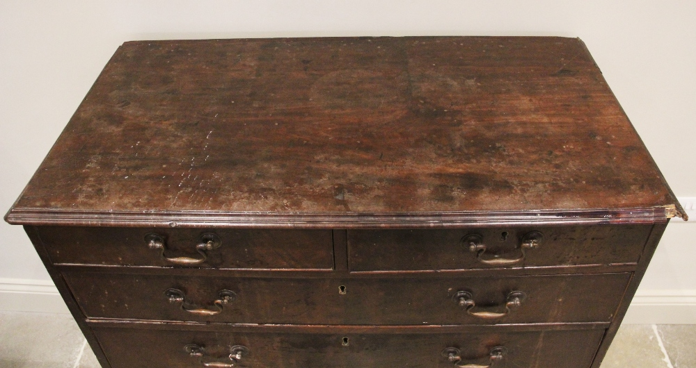 A George III mahogany chest of drawers, the rectangular moulded top over two short and four long - Image 2 of 2