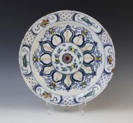 A Delft ware charger, 18th century, the polychrome tin glazed earthenware charger of circular