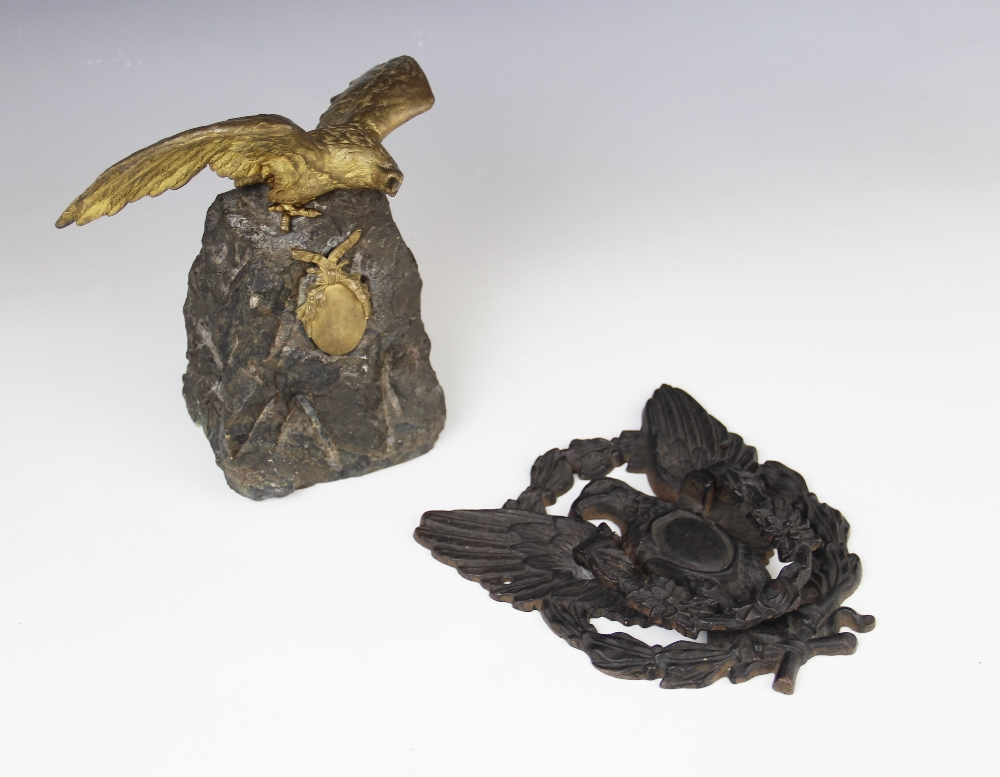 An early 20th century gilt metal figure of an eagle above a ribbon tied oval cartouche, mounted upon - Image 2 of 2