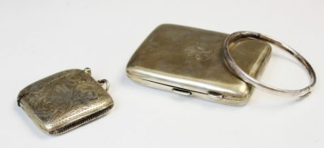 A George V silver cigarette case by Deakin & Francis, Birmingham 1918, of rectangular form with