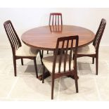 A mid century rosewood pedestal dining table, probably Indian rosewood, the circular table top on an