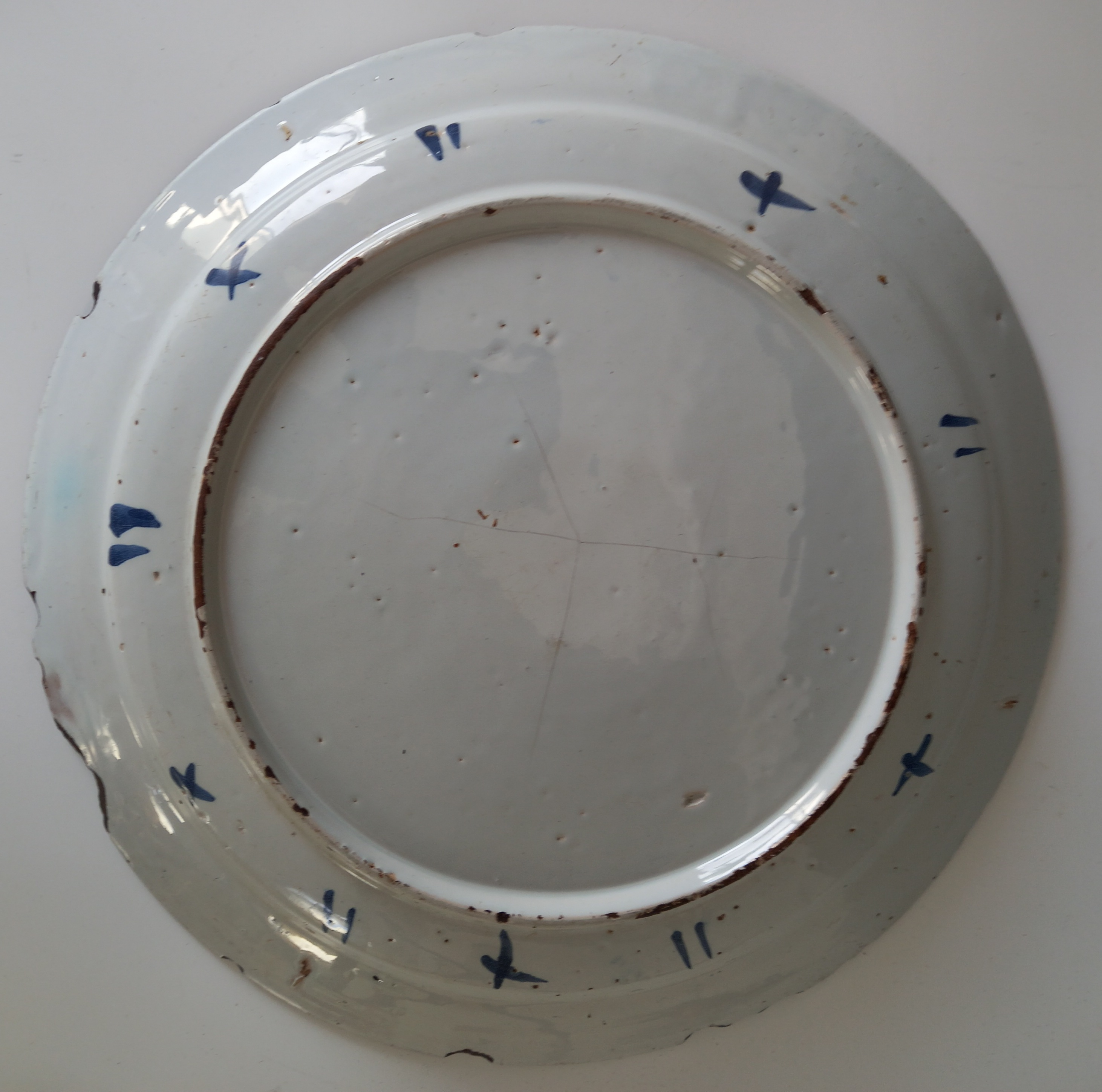 A Delft ware charger, 18th century, the tin glazed earthenware charger of circular form, the central - Image 6 of 6