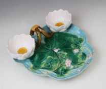 A George Jones majolica strawberry dish, late 19th century, modelled as a lily pad on ozier ground