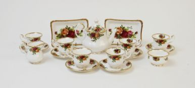 A Royal Albert miniature part tea service in the 'Old Country Roses' pattern, comprising; a teapot