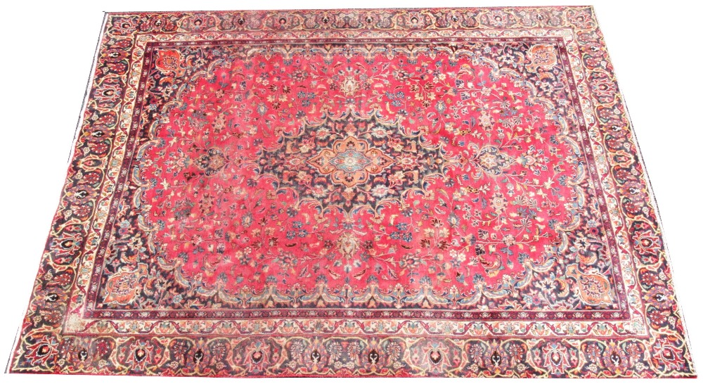 A large rich red multi coloured field Persian mashed carpet, with a traditional floral design, 370cm