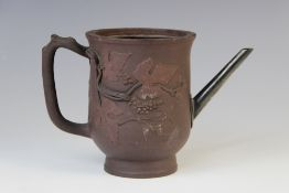 A Chinese Yixing teapot, 18th century, of bell form with naturalistic handle and relief moulded with