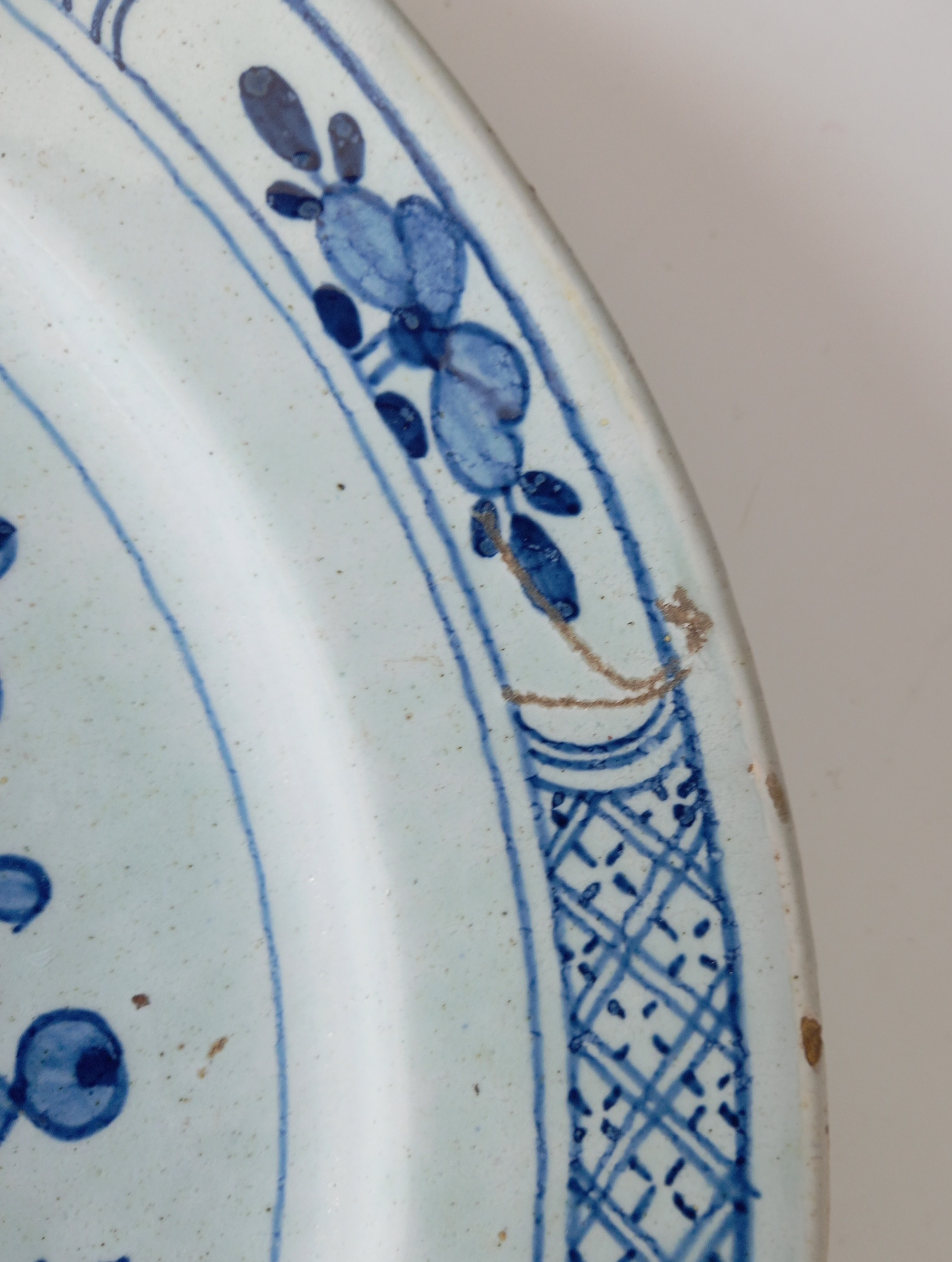 A Delft ware charger, 18th century, the tin glazed earthenware charger of circular form, the central - Image 4 of 5
