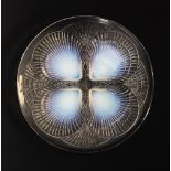 A Lalique 'Coquilles' plate, early 20th century, designed by René Lalique (1860-1945), the clear