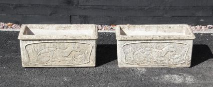 A pair of Yellowstone rectangular stone planters, each cast in relief with deer figures to the