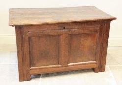 An 18th century and later oak coffer, the rectangular moulded top above a pair of invert moulded
