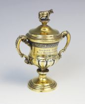 A George V miniature silver gilt cup and cover by Elkington & Co, Birmingham 1930, of baluster