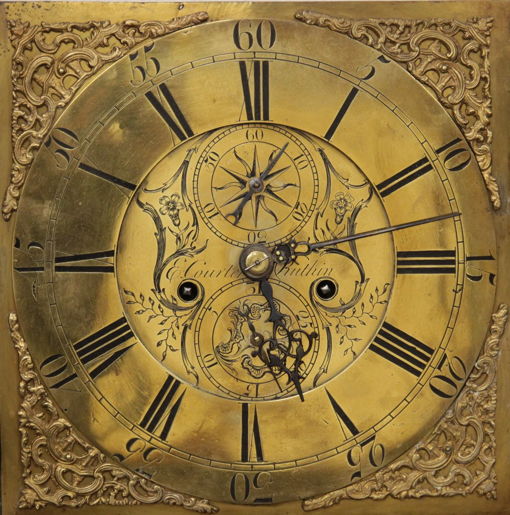 A George III oak cased eight day longcase clock by 'E Courter, Ruthin', the 30cm square brass dial