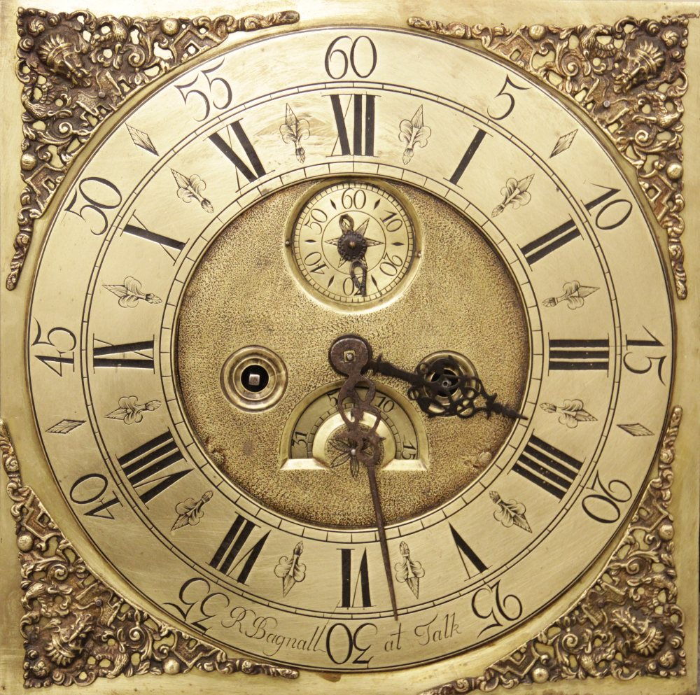 A George III oak and mahogany cross banded eight day longcase clock, signed 'R Bagnall at Talk', the