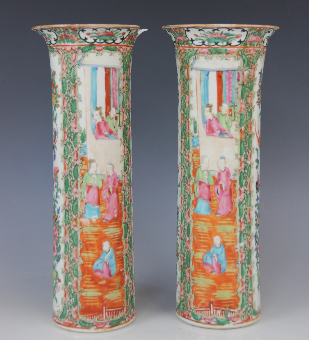 A pair of Chinese Canton vases, 19th century, each of cylindrical sleeve form and decorated in
